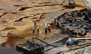 Workers drain away contaminated water after a spill at Zijinshan copper mine, China. The company claimed the incident was due to rainfall and was 'impossible to predict.' The spill resulted in severe contamination of the Ting river.