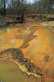 Acid mine drainage. Heavy metals color the water.